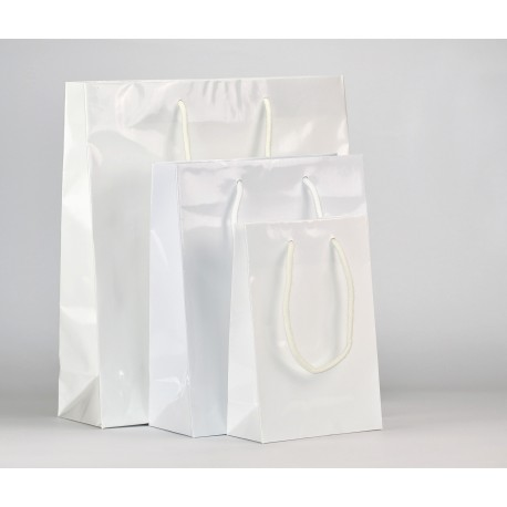 Shoppers in carta plastificata lucida, maniglie in cotone annodate